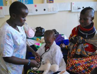 Engaging in medical play with a  young boy