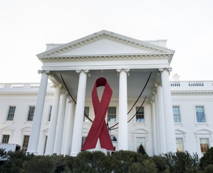 A red ribbon hangs over the North Portico of the White House in honor of World AIDS Day on Dec. 1, 2013.  (Brendan Smialowski/AFP/Getty Images)