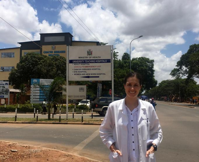 Tara Lane, MD outside of the University Teaching Hospital in Lusaka, Zambia, where she is completing a global health rotation as part of her med-peds residency training.
